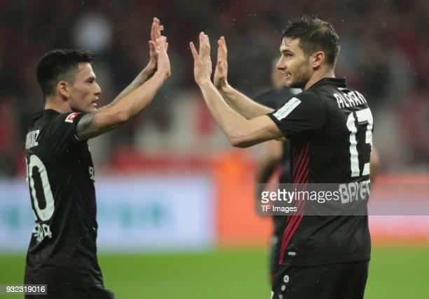 Lucas Alario of Leverkusen celebrates after scoring his team's first goal Charles Aranguiz of Leverkusen during the Bundesliga match between Bayer 04...