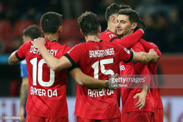 Lucas Alario of Leverkusen celebrates his team's third goal with team mates during the Bundesliga match between Bayer 04 Leverkusen and Fortuna...