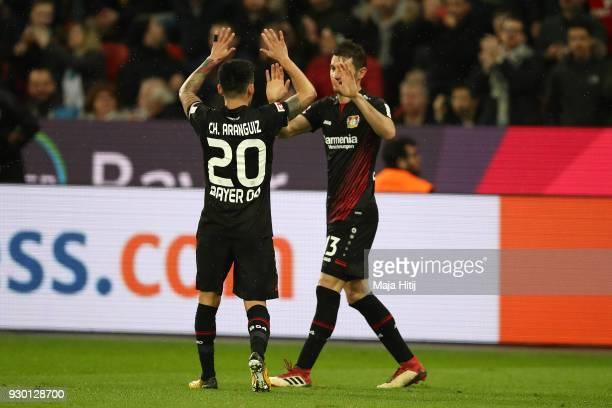 Lucas Alario of Leverkusen celebrates with Aranguiz of Bayer Leverkusen after he scored a goal to make it 10 during the Bundesliga match between...