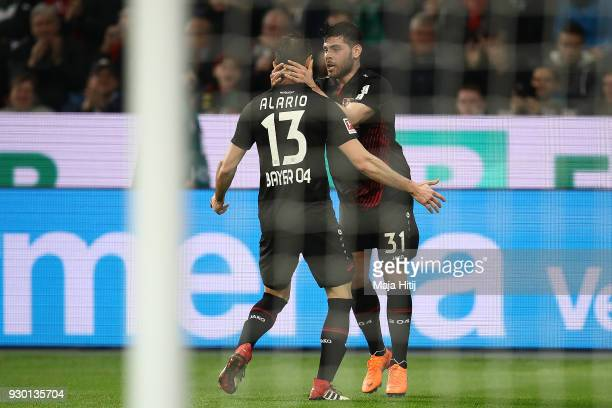 Lucas Alario of Leverkusen celebrates with Kevin Volland of Bayer Leverkusen after he scored a goal to make it 10 during the Bundesliga match between...