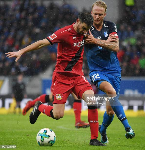 Lucas Alario of Leverkusen fights for the ball with Kevin Vogt of Hoffenheim during the Bundesliga match between TSG 1899 Hoffenheim and Bayer 04...