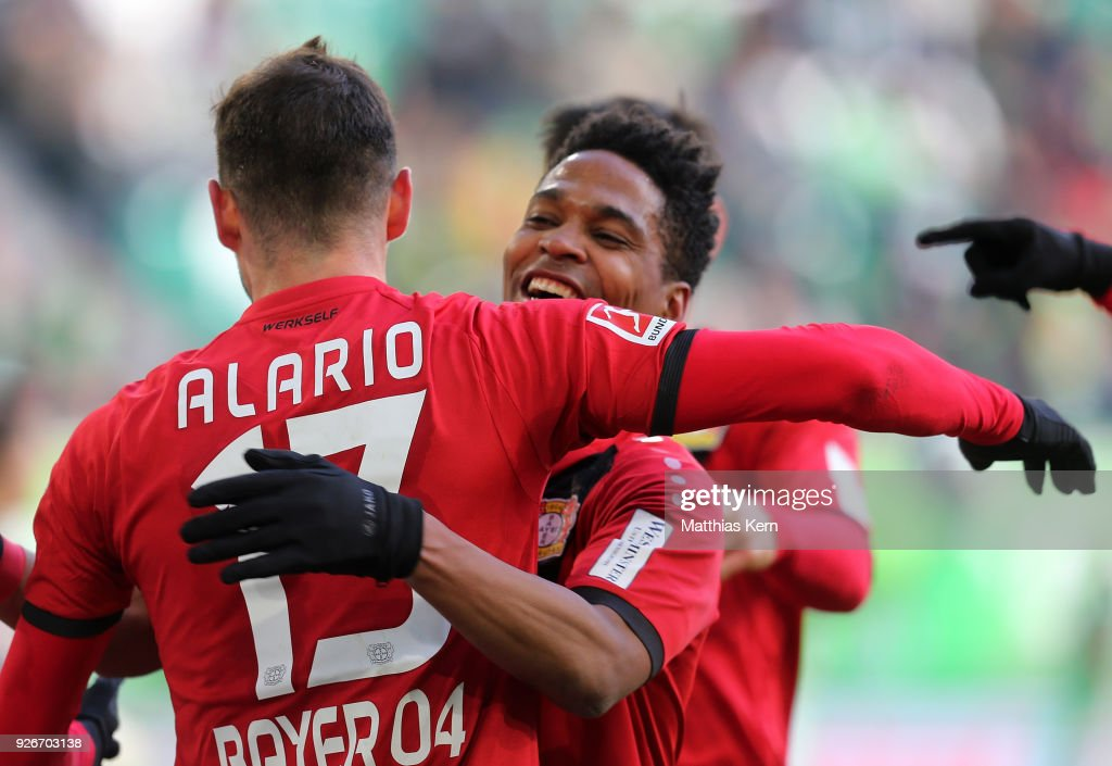 Lucas Alario (L) of Leverkusen jubilates with team mate Wendell after scoring the first goal after penalty during the Bundesliga match between VfL Wolfsburg and Bayer 04 Leverkusen at Volkswagen Arena on March 3, 2018 in Wolfsburg, Germany.