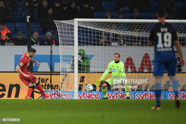 Lucas Alario of Leverkusen scores a goal past goalkeeper Oliver Baumann of Hoffenheim to make it 03 during the Bundesliga match between TSG 1899...