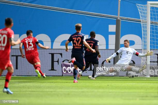 Lucas Alario of Leverkusen scores his team's first goal past goalkeeper Manuel Neuer of Muenchen during the Bundesliga match between Bayer 04...