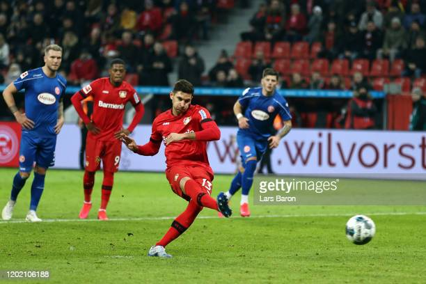 Lucas Alario of Leverkusen scores his team's third goal with a penalty during the Bundesliga match between Bayer 04 Leverkusen and Fortuna...