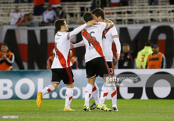 Lucas Alario of River Plate celebrates with his teammates after scoring the first goal of his team during a first leg match between River Plate and...