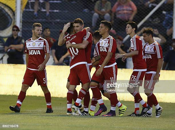 Lucas Alario of River Plate celebrates with teammates after scoring the first goal of his team during the match between Olimpo and River Plate as...