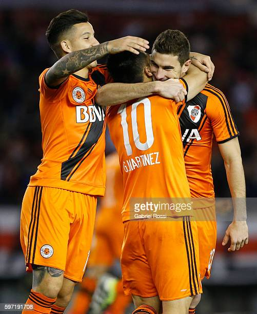 Lucas Alario of River Plate celebrates with teammates Gonzalo Martinez and Sebastian Driussi after scoring the second goal of his team during a match...