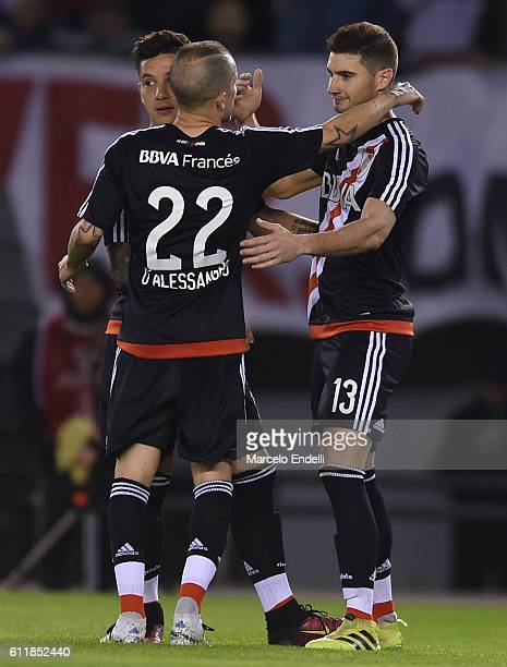 Lucas Alario of River Plate celebrates with teammates Sebastian Driussi and Andres D'Alessandro after scoring the second goal of his team during a...