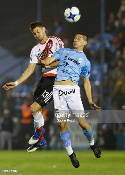 Lucas Alario of River Plate fights for the ball with Rodrigo De Ciancio of Temperley during a match between Temperley and River Plate as part of...