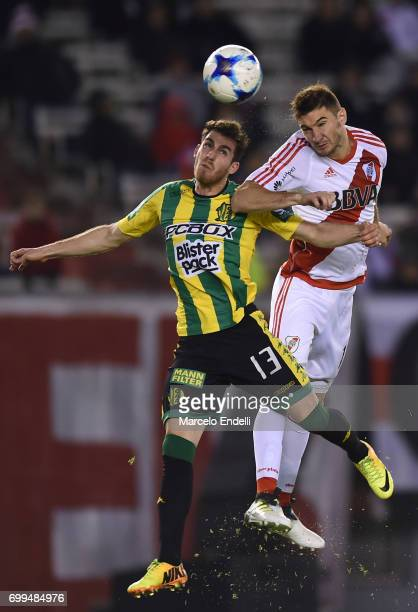 Lucas Alario of River Plate goes for a header with Ramiro Arias of Aldosivi during a match between River Plate and Aldosivi as part of Torneo Primera...