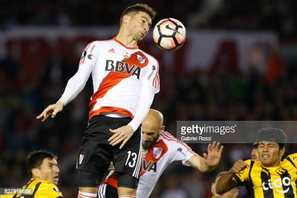 Lucas Alario of River Plate heads the ball during a second leg match between River Plate and Guarani as part of round of 16 of Copa CONMEBOL...