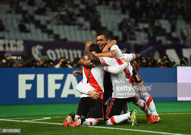 Lucas Alario of River Plate is congratulated by teammates after scoring during the FIFA Club World Cup semi final match between Sanfrecce Hiroshima...