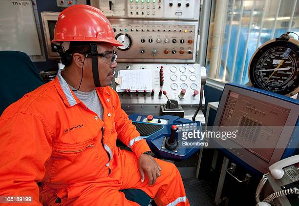 Lucas Arrellano control room supervisor checks the digital drill machine on the Tonal oil rigs owned by Mexican oil company Pemex located 65 miles...