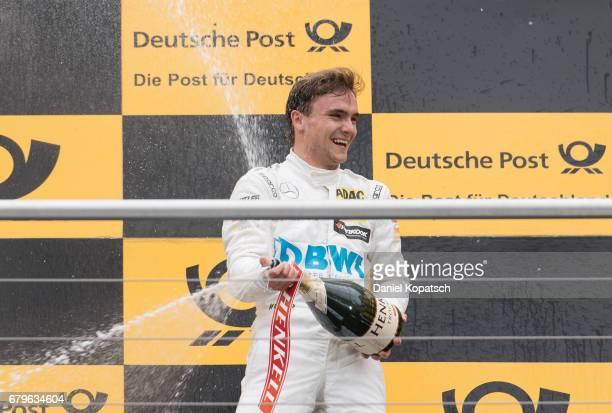 Lucas Auer of MercedesAMG Motorsport BWT celebrates after winning race 1 of the DTM German Touring Car Hockenheim at Hockenheimring on May 6 2017 in...