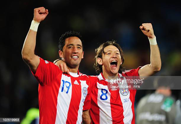 Lucas Barrios and Edgar Barreto of Paraguay celebarte after the 2010 FIFA World Cup South Africa Round of Sixteen match between Paraguay and Japan at...