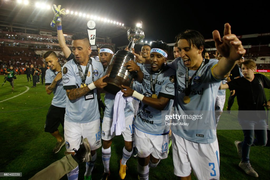 Lucas Barrios, Bruno Cortez and Geromel of Gremio celebrate with the trophy after winning the second leg match between Lanus and Gremio as part of Copa Bridgestone Libertadores 2017 Final at Ciudad de Lanus Stadium on November 29, 2017 in Lanus, Argentina.