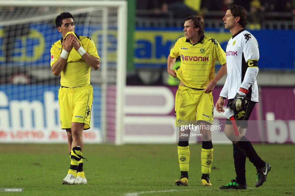 Lucas Barrios, Kevin Grosskreutz and goalkeeper Roman Weidenfeller (L-R) of Dortmund react after the Bundesliga match between 1. FC Kaiserslautern and Borussia Dortmund at Fritz-Walter-Stadion on February 12, 2011 in Kaiserslautern, Germany.