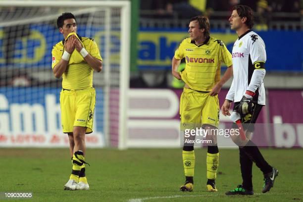 Lucas Barrios Kevin Grosskreutz and goalkeeper Roman Weidenfeller of Dortmund react after the Bundesliga match between 1 FC Kaiserslautern and...