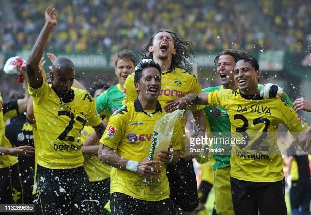 Lucas Barrios Kevin Grosskreutz Antonio Da Silva and Felipe Santana of Dortmund celebrates winning the league title at the end of the Bundesliga...