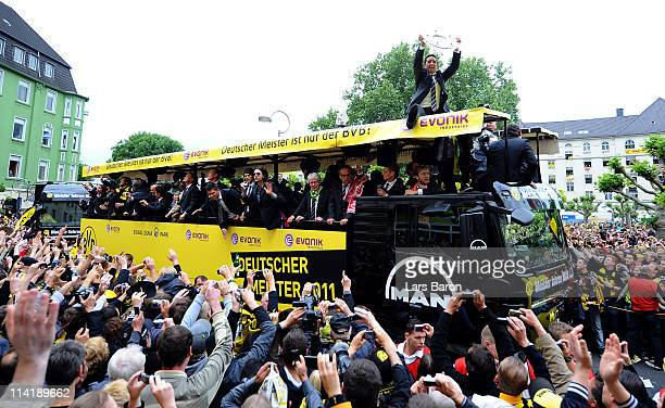 Lucas Barrios lifts the trophy and celebrates winning the German championship with team mates and fans during the Borussia Dortmund Bundesliga...
