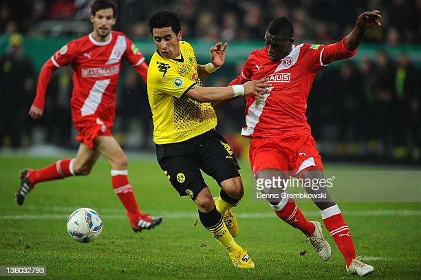Lucas Barrios of Dortmund and Lukimya of Duesseldorf battle for the ball during the DFB Cup round of sixteen match between Fortuna Duesseldorf and...