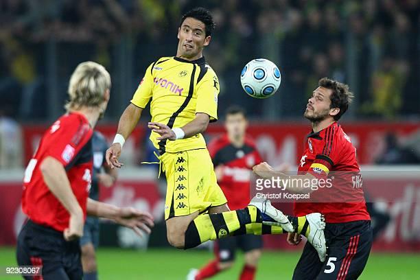 Lucas Barrios of Dortmund and Manuel Friedrich of Leverkusen go up for a header during the Bundesliga match between Bayer Leverkusen and Borussia...