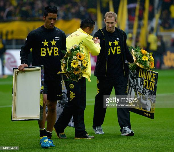 Lucas Barrios of Dortmund and teammates Antonio da Silva and Florian Kringe walk on the pitch prior to the Bundesliga match between Borussia Dortmund...