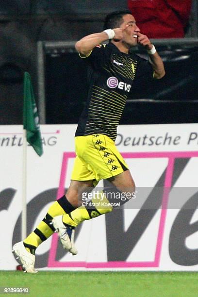 Lucas Barrios of Dortmund celebrates a goal during the Bundesliga match between SV Werder Bremen and Borussia Dortmund at the Weser Stadium on...