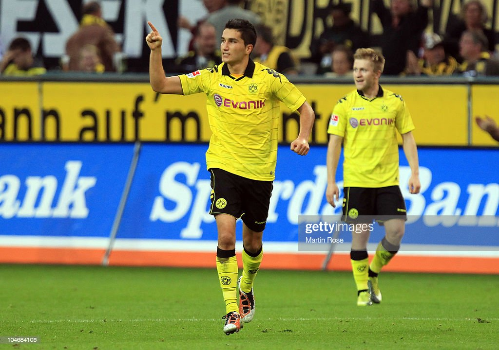 Lucas Barrios of Dortmund celebrates after he scores his team's 2nd goal during the Bundesliga match between Borussia Dortmund and FC Bayern Muenchen at the Signal Iduna Park on October 3, 2010 in Dortmund, Germany.