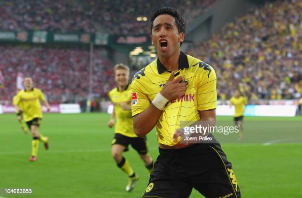 Lucas Barrios of Dortmund celebrates after scoring his team's first goal during the Bundesliga match between Borussia Dortmund and FC Bayern Muenchen...