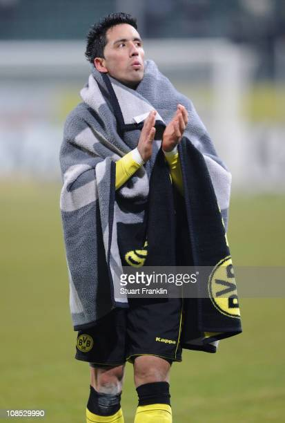 Lucas Barrios of Dortmund celebrates at the end of the Bundesliga match between VfL Wolfsburg and Borussia Dortmund at Volkswagen Arena on January 29...