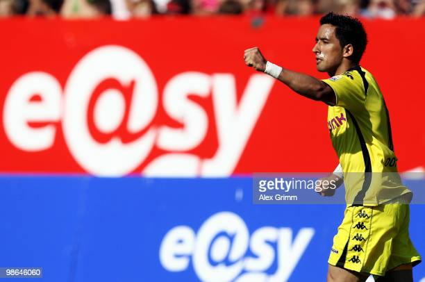 Lucas Barrios of Dortmund celebrates his team's second goal during the Bundesliga match between 1 FC Nuernberg and Borussia Dortmund at the Easy...
