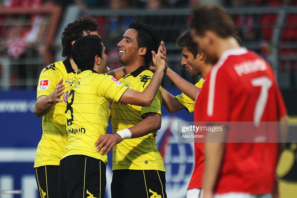 Lucas Barrios (C) of Dortmund celebrates his team's second goal with team mates during the Bundesliga match between FSV Mainz 05 and Borussia Dortmund at the Bruchweg Stadium on October 31, 2010 in Mainz, Germany.