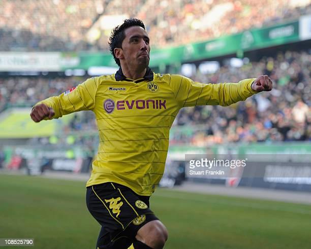 Lucas Barrios of Dortmund celebrates scoring his goal during the Bundesliga match between VfL Wolfsburg and Borussia Dortmund at Volkswagen Arena on...