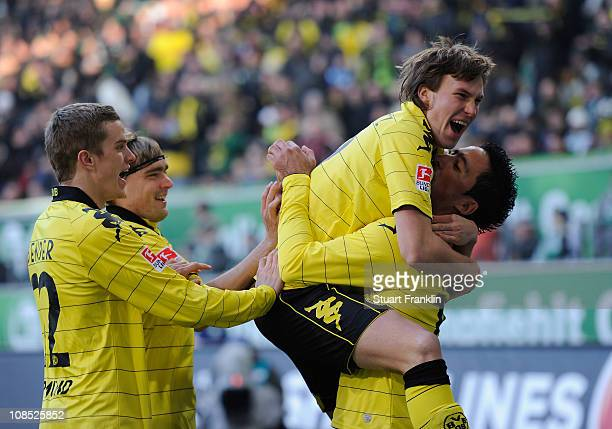 Lucas Barrios of Dortmund celebrates scoring his goal with Mario Goetze during the Bundesliga match between VfL Wolfsburg and Borussia Dortmund at...