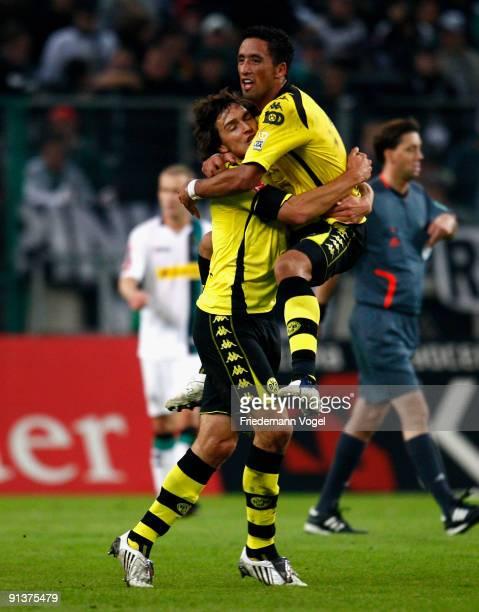 Lucas Barrios of Dortmund celebrates scoring his team's first goal with team mate Mats Julian Hummels during the Bundesliga match between Borussia...