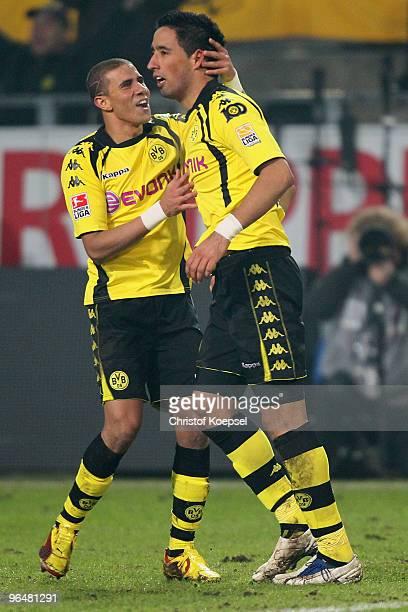 Lucas Barrios of Dortmund celebrates the second goal with Mohamed Zidan of Dortmund during the Bundesliga match between Borussia Dortmund and...