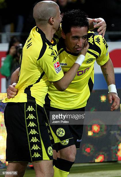Lucas Barrios of Dortmund celebrates with his team mate Mohamed Zidan after scoring his team's first goal during the Bundesliga match between...