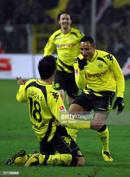 Lucas Barrios of Dortmund celebrates with team mate Antonio da Silva after scoring his teams fourth goal during the Bundesliga match between Borussia...