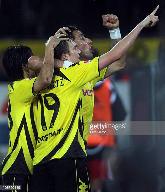 Lucas Barrios of Dortmund celebrates with team mates after scoring the second goal during the Bundesliga match between Borussia Dortmund and...