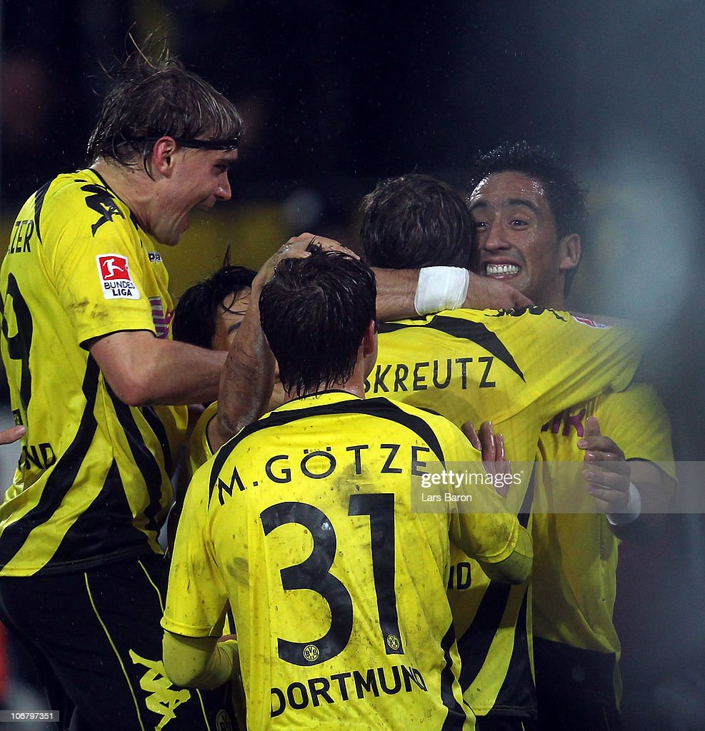 Lucas Barrios of Dortmund celebrates with team mates after scoring the second goal during the Bundesliga match between Borussia Dortmund and Hamburger SV at Signal Iduna Park on November 12, 2010 in Dortmund, Germany.