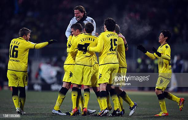 Lucas Barrios of Dortmund celebrates with team mates after scoring his teams second goal during the Bundesliga match between 1 FC Nuernberg and...