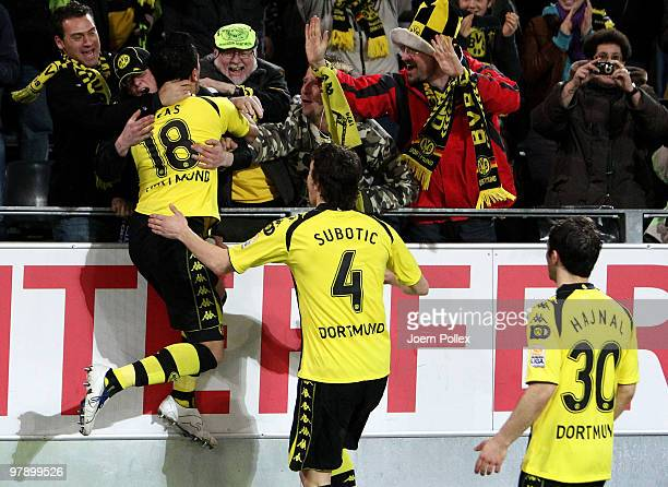 Lucas Barrios of Dortmund celebrates with the fans after scoring his team's first goal during the Bundesliga match between Borussia Dortmund and...