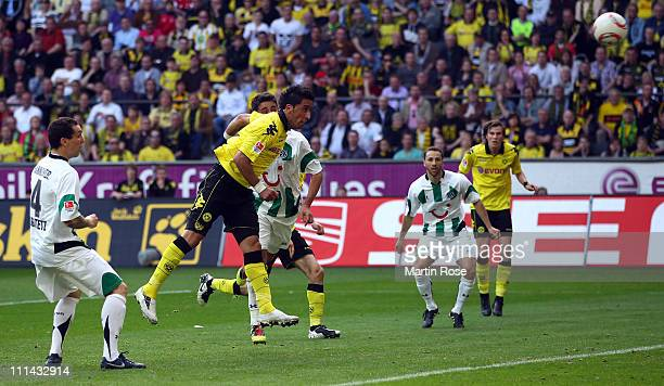 Lucas Barrios of Dortmund head's his team's 2nd goal during the Bundesliga match between Borussia Dortmund and Hannover 96 at the Signal Iduna Park...