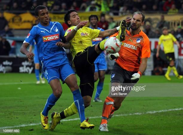 Lucas Barrios of Dortmund is challenged by Luiz Gustavo and goalkeeper Tom Starke of Hoffenheim during the Bundesliga match between Borussia Dortmund...