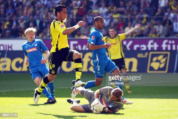 Lucas Barrios of Dortmund jumps over goalkeeper Timo Hildebrand of Hoffenheim during the Bundesliga match between Borussia Dortmund and 1899...