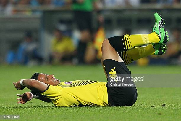 Lucas Barrios of Dortmund lies dejected onm the pitch during the UEFA Champions League group F match between Olympique Marseille and Borussia...