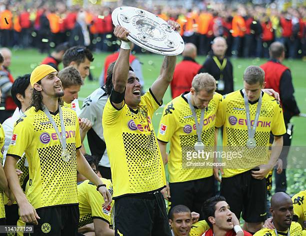 Lucas Barrios of Dortmund lifts the German Championship trophy on the podium after the Bundesliga match between Borussia Dortmund and Eintracht...
