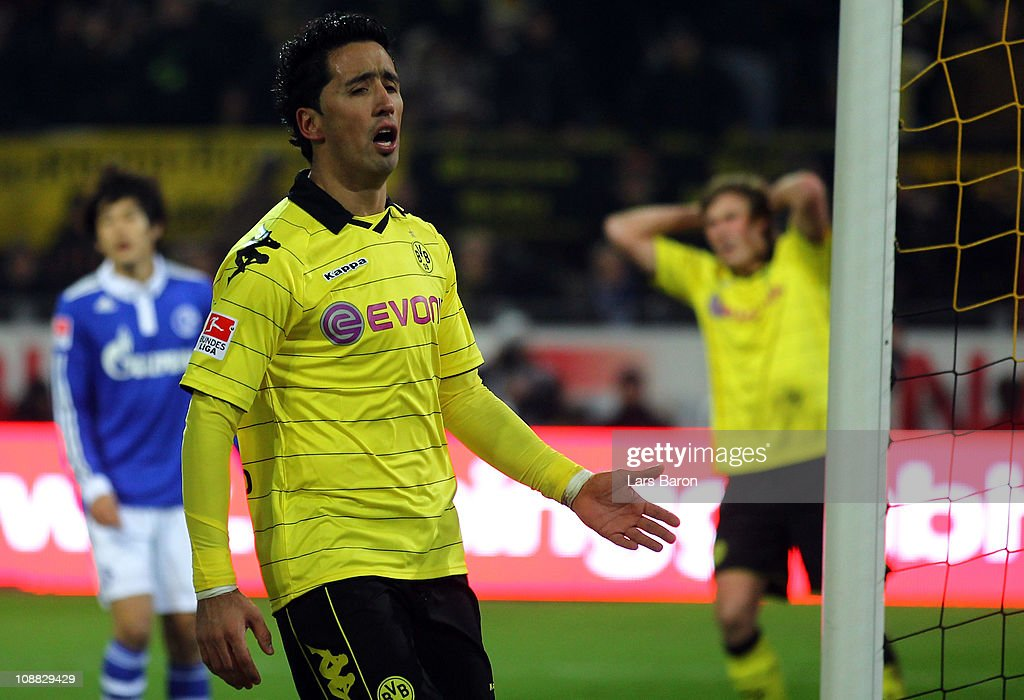 Lucas Barrios of Dortmund looks dejected next to team mate Kevin Grosskreutz during the Bundesliga match between Borussia Dortmund and FC Schalke 04 at Signal Iduna Park on February 4, 2011 in Dortmund, Germany.